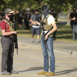 Utah Citizens' Alarm members carry firearms as they gather at Valley Regional Park in Taylorsville on Friday, July 10, 2020.