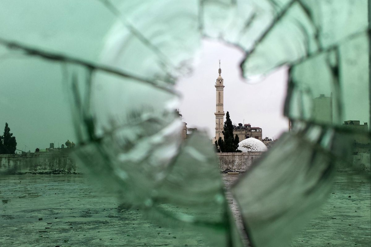 A mosque, as seen through shattered glass in Homs' Old City.