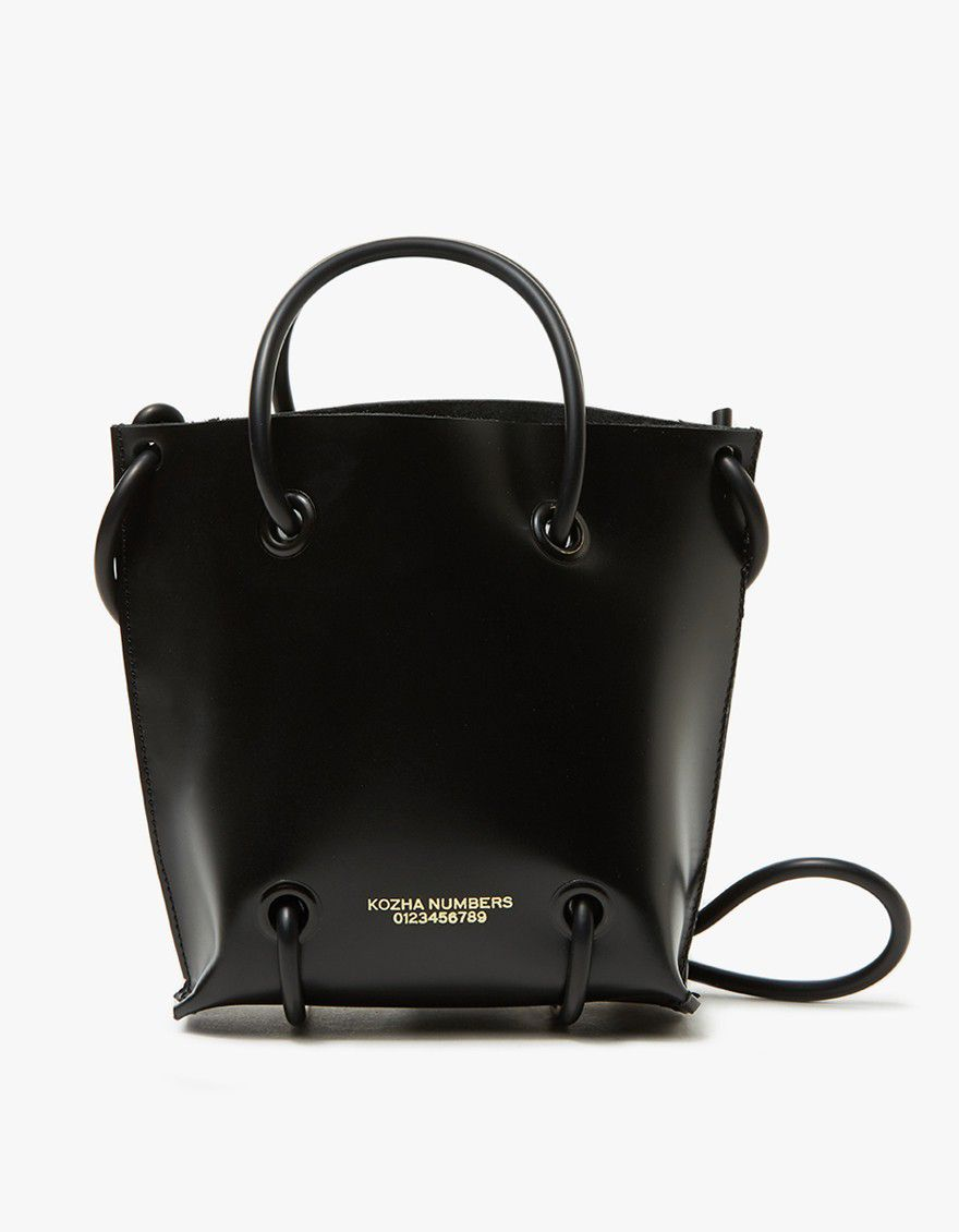 Black leather bag with knoted strap.