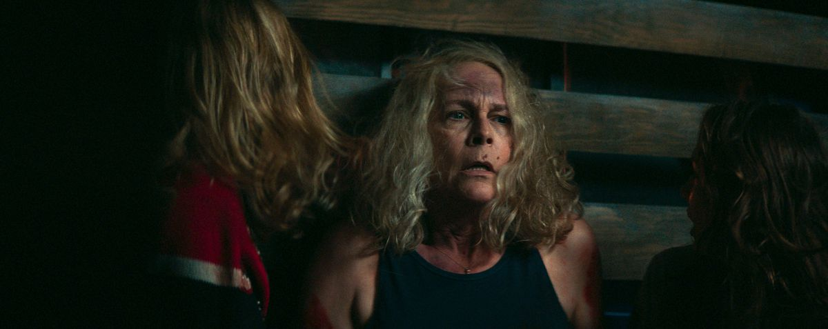 Laurie catches her breath in the back of a truck in Halloween Kills