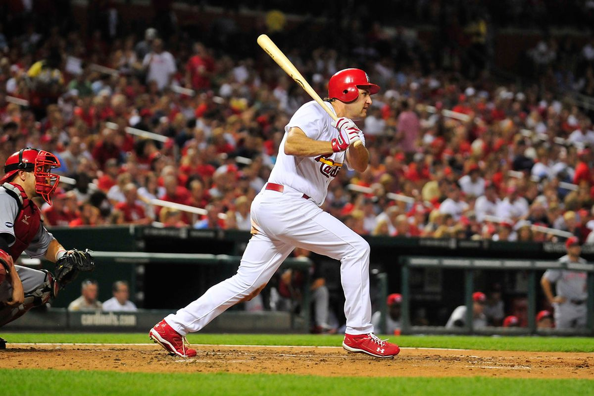 ST. LOUIS, MO - SEPTEMBER 2: Lance Berkman #12 of the St. Louis Cardinals follows through on an RBI single against the Cincinnati Reds at Busch Stadium on September 2, 2011 in St. Louis, Missouri.  (Photo by Jeff Curry/Getty Images)