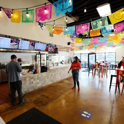 Customers place orders and eat at Santo Taco in Salt Lake City on Wednesday, Dec. 9, 2020. According to census data, Utahns as a whole are bringing in more money, but those of minority racial and ethnic backgrounds aren't taking home equal pieces of the pie.
