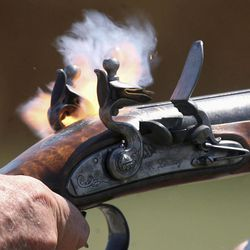 In an Aug. 23, 2012 photo, it all starts with a spark, as one barrel of a double-barrelled shotgun made by Chuck Lindsey fires during a trapshooting session in rural southwest Logan County, Ill. Lindsey builds muzzle-loading firearms, especially flintlocks that were in use in the late 18th and early 19th centuries.