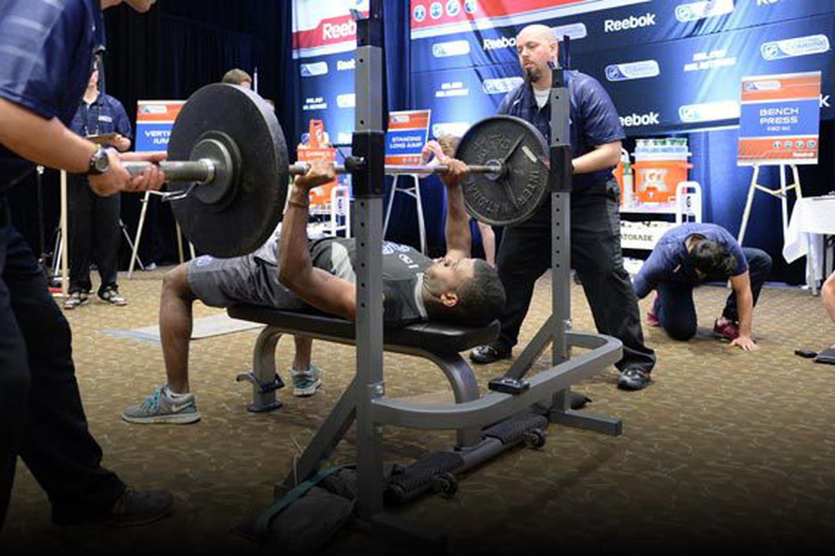 Draft prospects perform as many reps as possible of 150 pounds on the bench press at the 2013 NHL Scouting Combine in Toronto. Photo courtesy of -