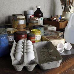Eggs and egg shells are seen amongst other supplies during a preview tour of the home and studio of artist Andrew Wyeth Monday, April 23, 2012 in Chadd's Ford, Pa. The studio will be open for tours in the summer of 2012 by the Brandywine River Museum. The eggs are for making his signature medium _ egg tempera, a thick mixture of yolks, pigment and distilled water.