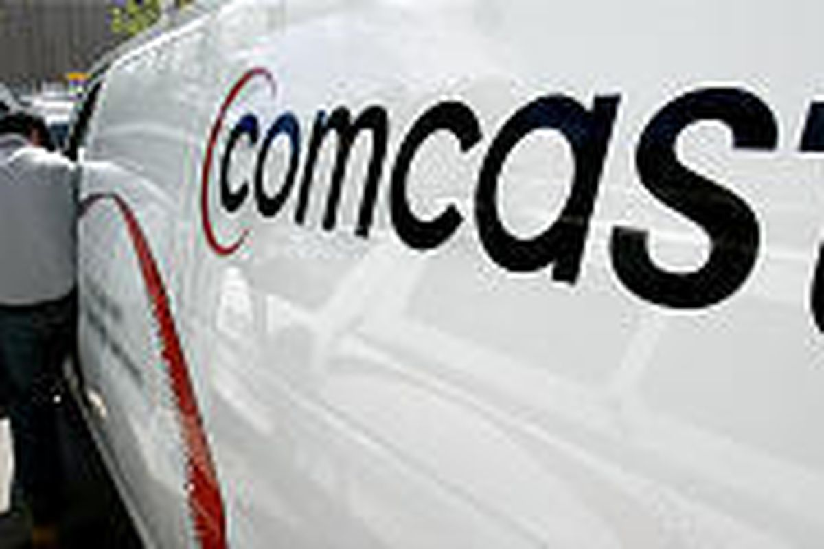 Comcast's T.J. Berrett heads out on a service call in August in Salt Lake City. Comcast is the nation's largest cable television operator.
