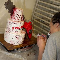 Air brushing blood on the Evil Dead cake.