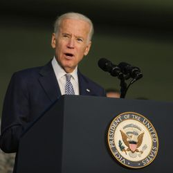 """FILE """""""" Joe Biden, former U.S. Vice President, talks to the U.S. military personnel at an Air Base in United Arab Emirates, Monday, March 7, 2016. Biden said Mitt Romney should run for the Senate, according to news reports of their Friday evening event at Romney's annual retreat that brings together political and business leaders."""