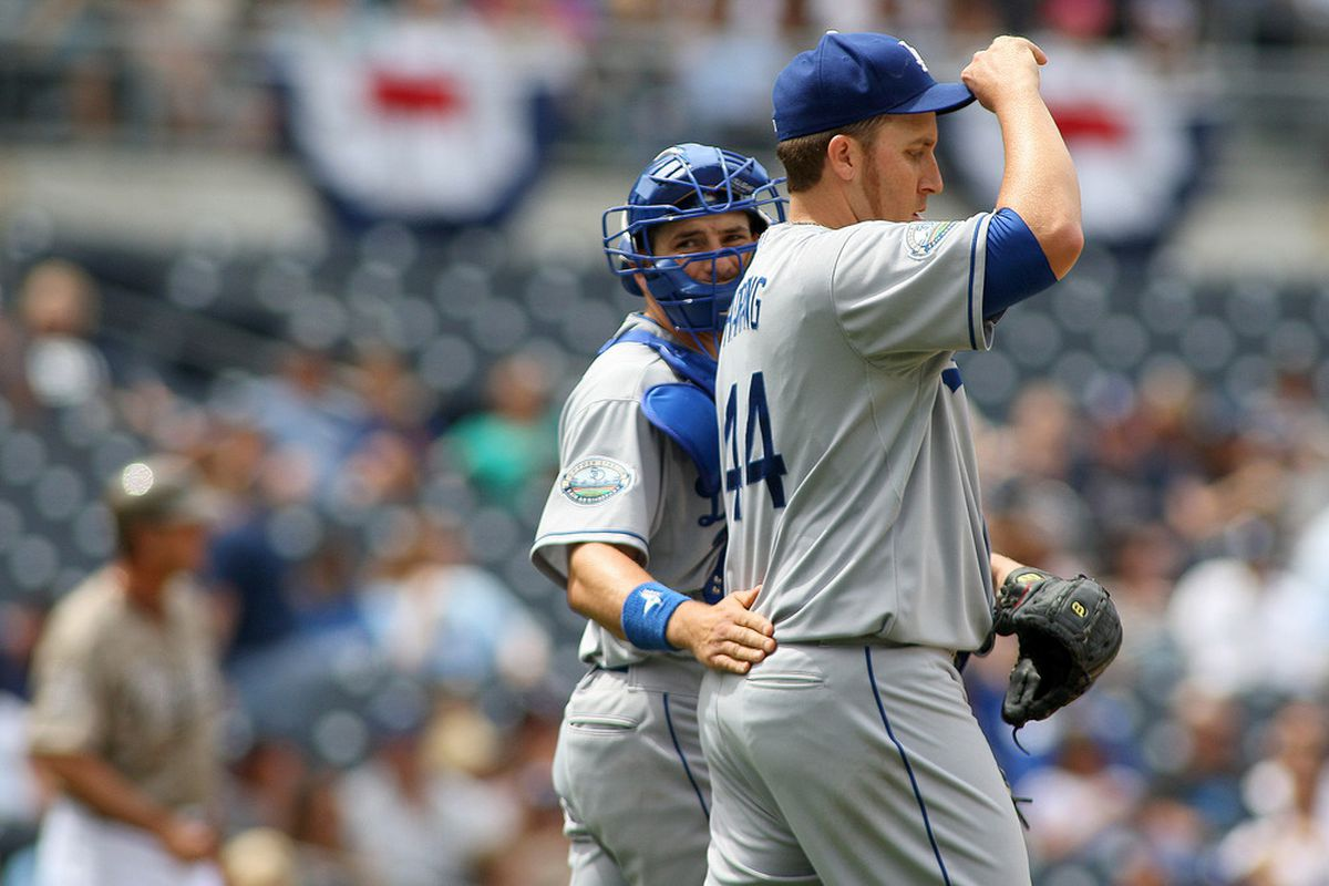 Apr 8, 2012; San Diego, CA, USA; Los Angeles Dodgers catcher Matt Treanor (left) talks to starting pitcher Aaron Harang (44) during the third inning against the San Diego Padres at PETCO Park.  Mandatory Credit: Jake Roth-US PRESSWIRE