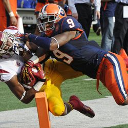 Southern California wide receiver Robert Woods, left, scores on a touchdown reception against Syracuse cornerback Ri'Shard Anderson during the second quarter of an NCAA college football game Saturday, Sept. 8, 2012, in East Rutherford, N.J.