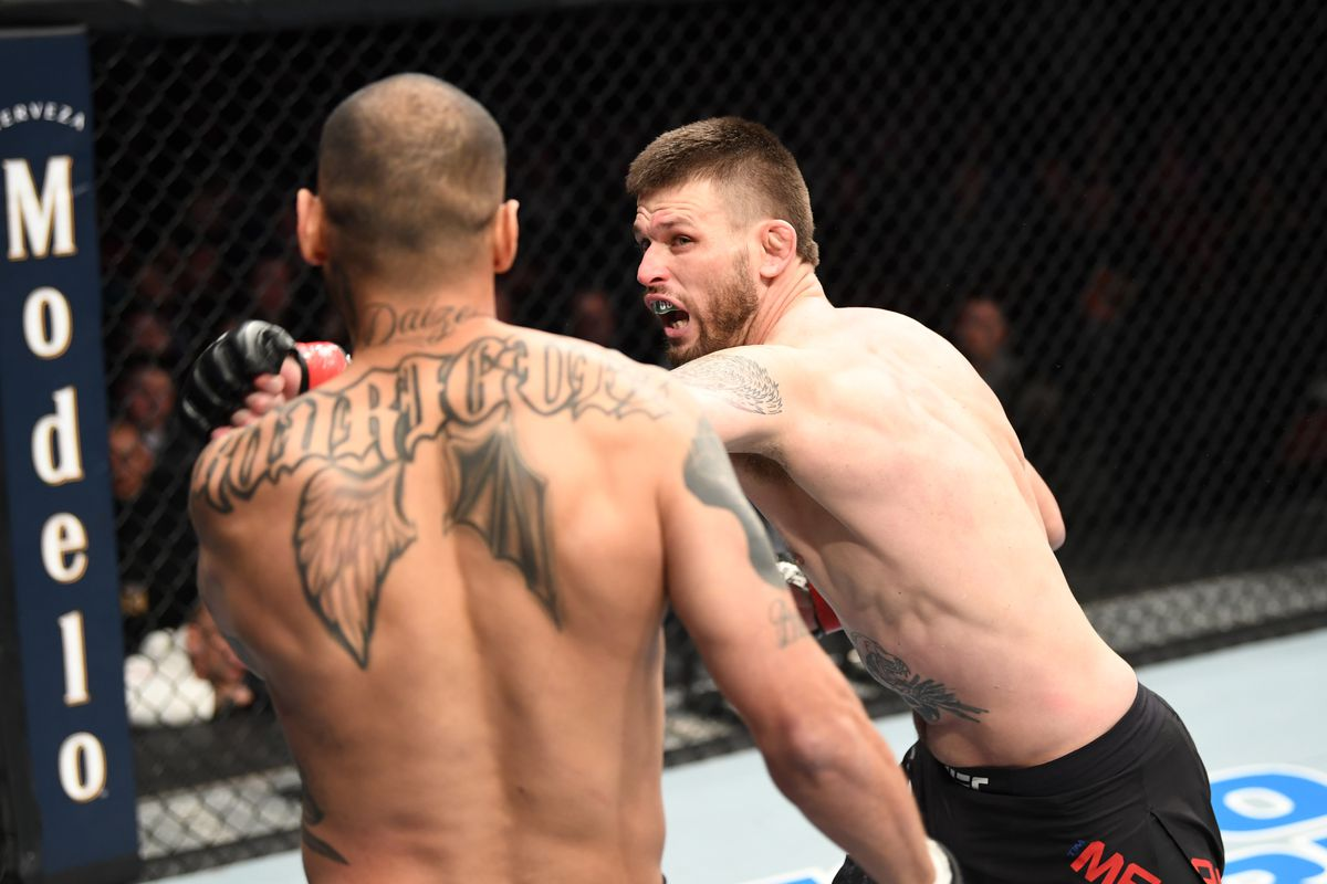 Tim Means punches Daniel Rodriguez in their welterweight bout during the UFC Fight Night event at Santa Ana Star Center on February 15, 2020 in Rio Rancho, New Mexico.