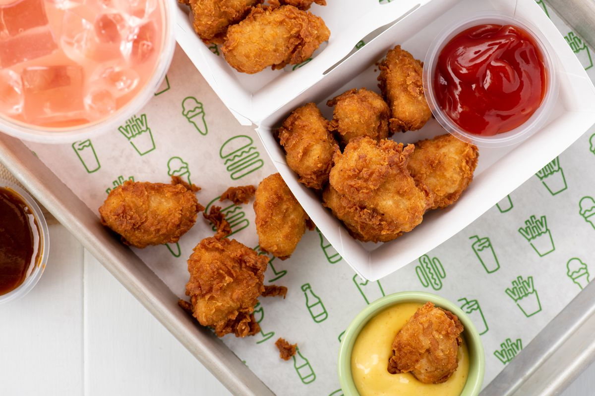 Shake Shack chicken nuggets on a tray with dipping sauces