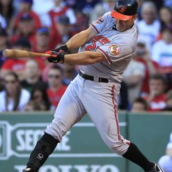 Baltimore Orioles' Jim Thome hits a ground rule double off a pitch by Boston Red Sox's Andrew Bailey in the ninth inning of a baseball game at Fenway Park, in Boston, Sunday, Sept. 23, 2012. The Red Sox won 2-1.