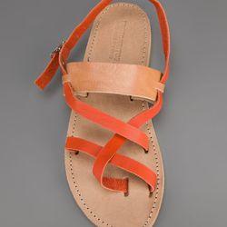 "<a href=""http://www.farfetch.com/shopping/women/erotokritos-strappy-flat-sandal-item-10376957.aspx?storeid=9401"">Erotokritos Strappy Flat Sandal</a>, $81 at FarFetch"
