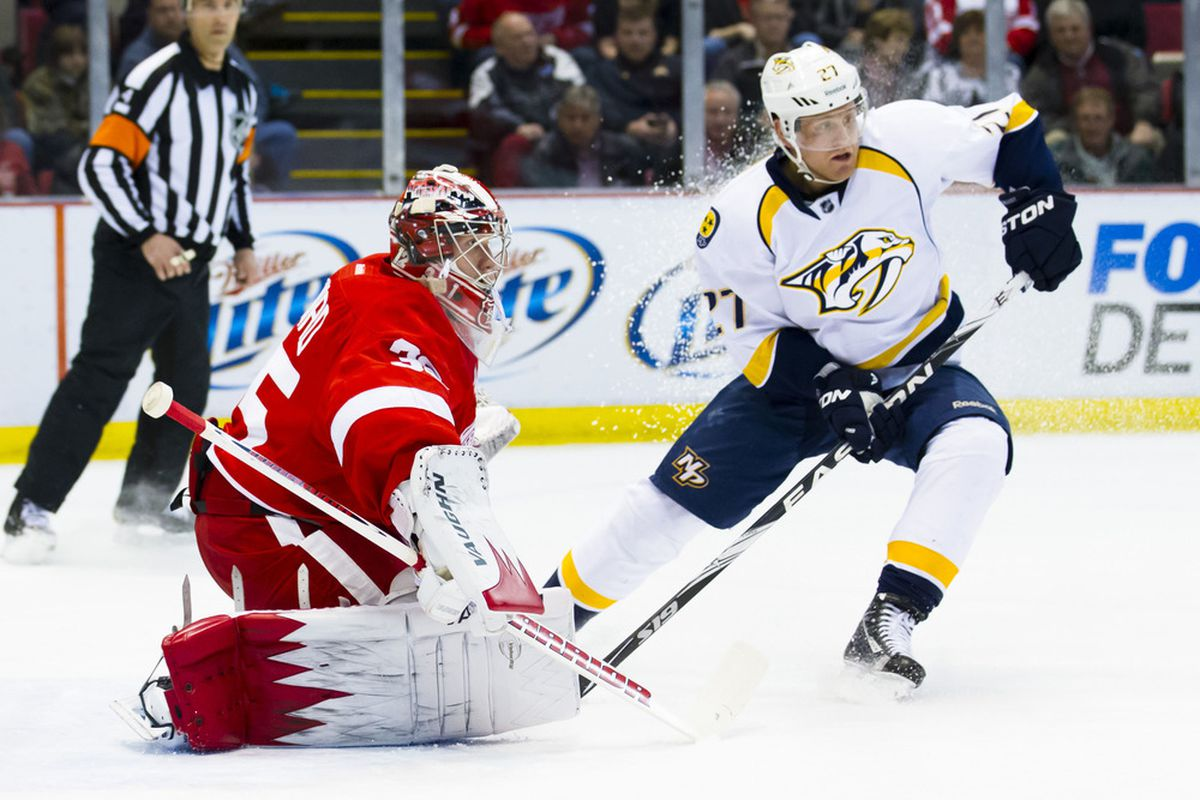 March 30, 2012; Detroit, MI, USA; Nashville Predators right wing Patric Hornqvist (27) stops short in front of Detroit Red Wings goalie Jimmy Howard (35) in the first period at Joe Louis Arena. Mandatory Credit: Rick Osentoski-US PRESSWIRE
