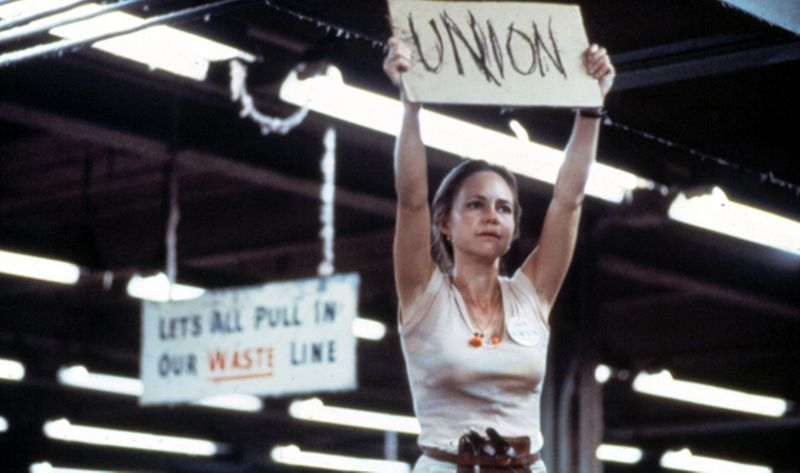 "Norma Rae screencap of Sally Fields holding a ""UNION"" sign"