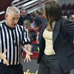 The referee explains a call to USC head coach Cynthia Cooper-Dyke.
