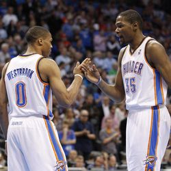 Oklahoma City Thunder guard Russell Westbrook (0) and forward Kevin Durant (35) slap hands as part of their pregame ritual before an NBA basketball game against the Los Angeles Clippers in Oklahoma City, Wednesday, April 11, 2012.