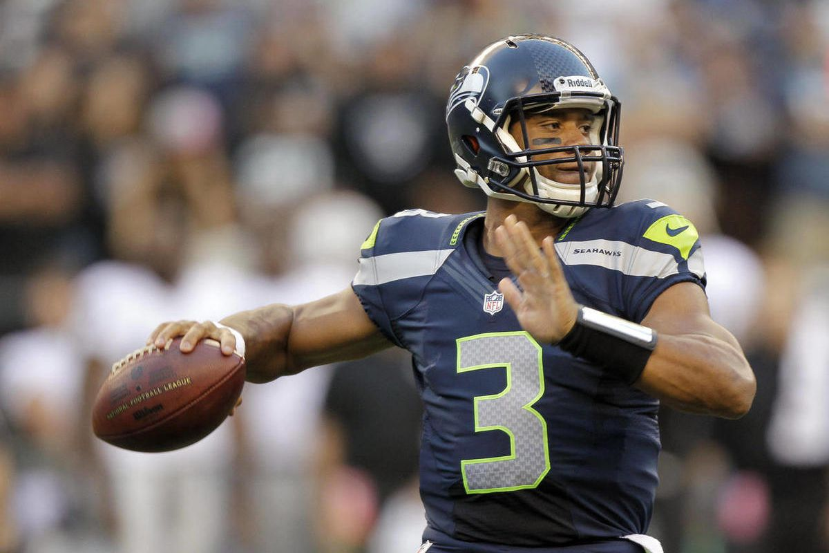 FILE - This Aug. 30, 2012 file photo shows Seattle Seahawks rookie quarterback Russell Wilson dropping back to pass against the Oakland Raiders in the first half of a preseason NFL football game in Seattle. Youth and inexperience have taken over the most