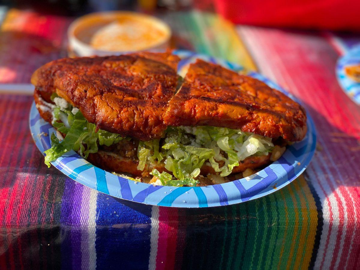 The pambazo at Estilo Chilanga: potatoes, chorizo, and Cotija cheese on a dipped and griddled telera roll