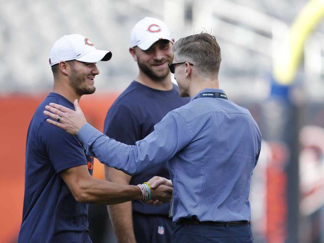 Bears general manager Ryan Pace (right, greeting Mitch. Trubisky and Kyle Long before a preseason game against the Titans in 2018) has taken one quarterback out of 39 picks over six NFL drafts.