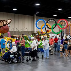 People tour the Days of '47 Float Preview Party at the Mountain America Expo Center in Sandy on Tuesday, July 20, 2021.