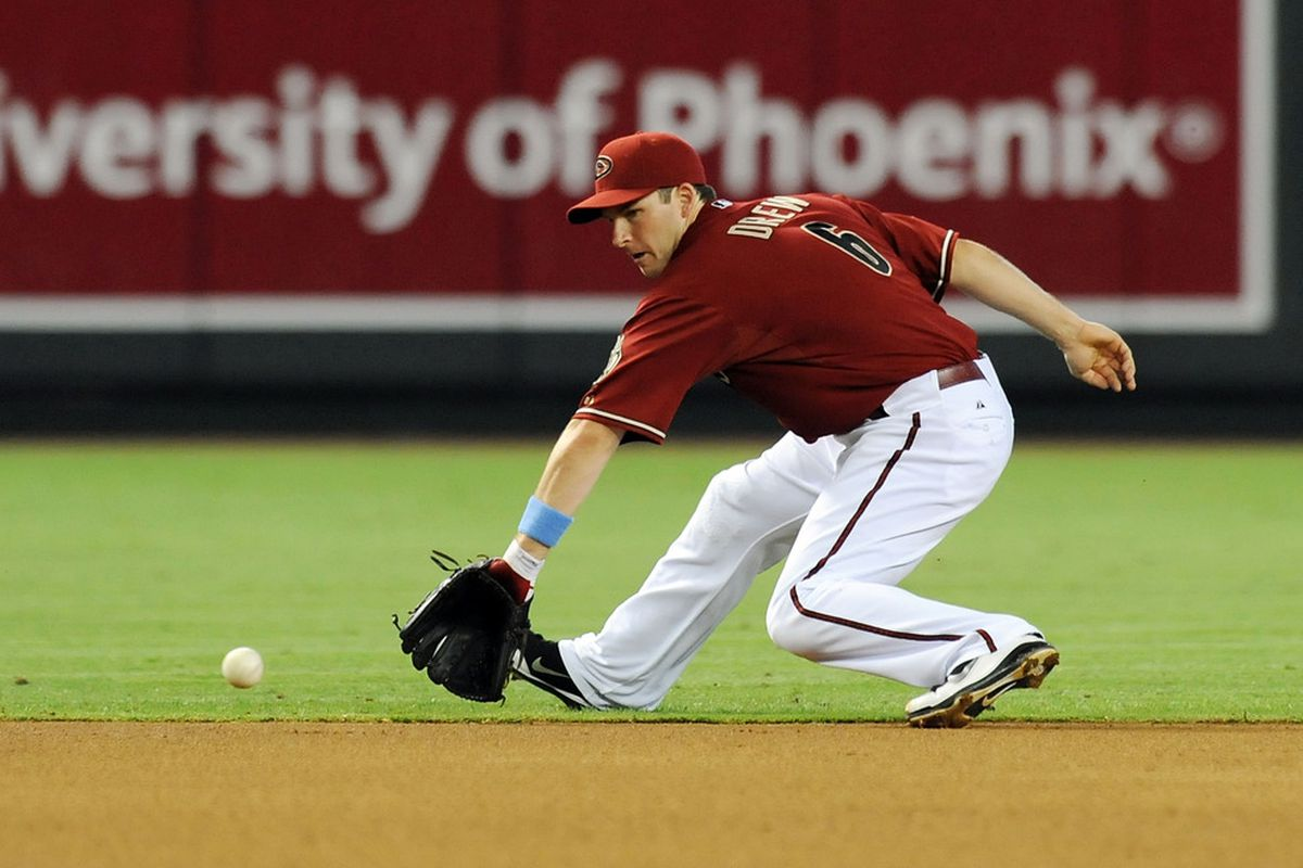 PHOENIX, AZ - JUNE 19: Stephen Drew #6 of the Arizona Diamondbacks makes a back hand stop against the Chicago White Sox at Chase Field on June 19, 2011 in Phoenix, Arizona.  (Photo by Norm Hall/Getty Images)
