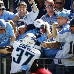 Tennessee Titans' Tommie Campbell celebrates with fans after scoring a touchdown on a 65-yard punt return against the Detroit Lions in the first quarter of an NFL football game, Sunday, Sept. 23, 2012, in Nashville, Tenn.
