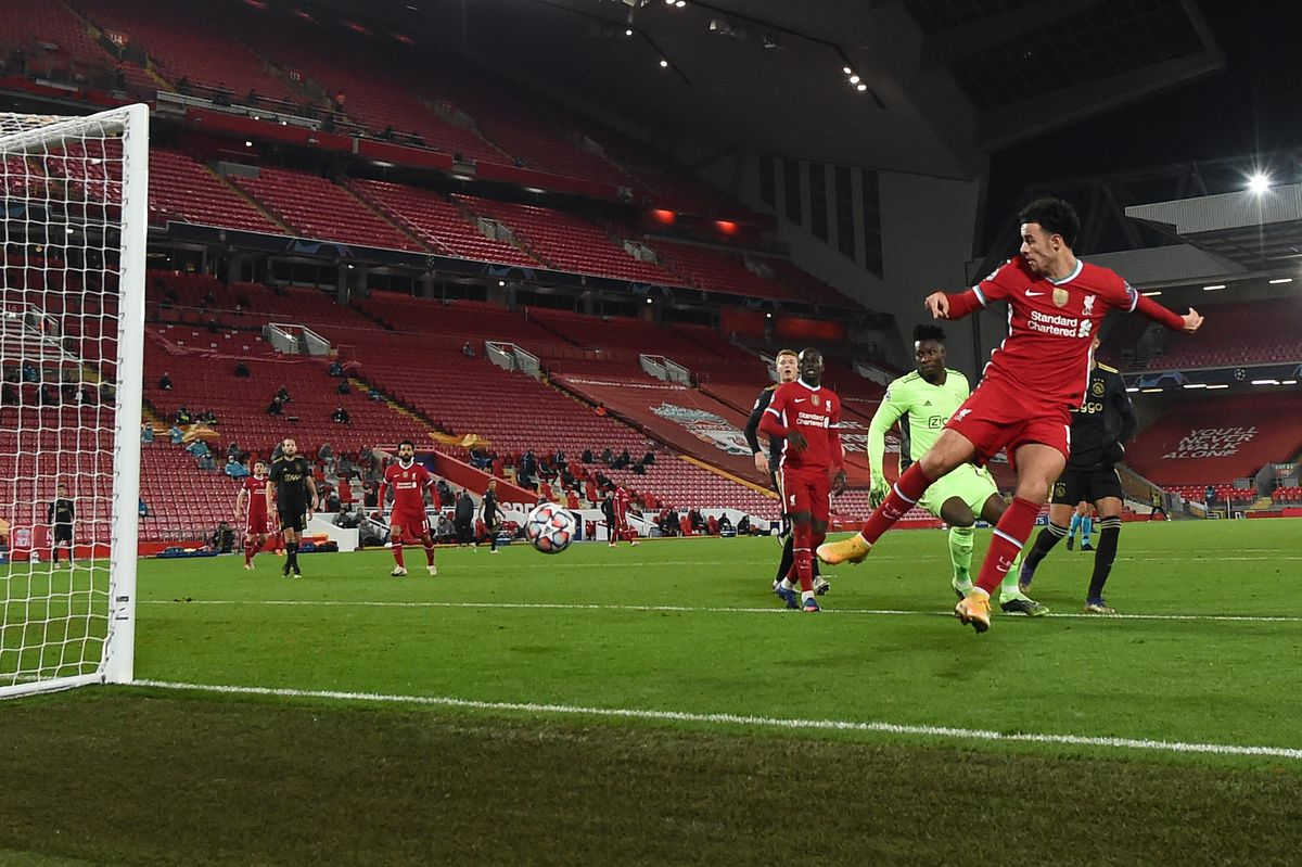 Curtis Jones of Liverpool scores their team's first goal during the UEFA Champions League Group D stage match between Liverpool FC and Ajax Amsterdam at Anfield on December 01, 2020