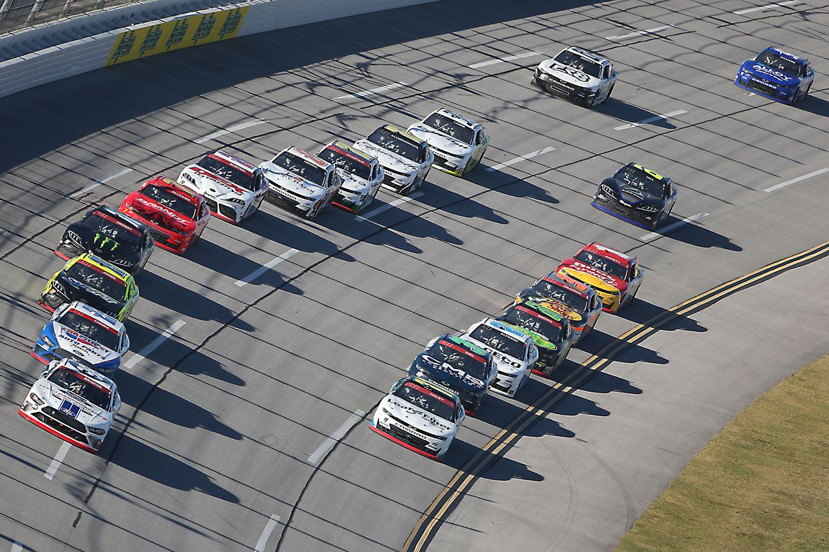 Chase Briscoe, driver of the #98 Ford Performance Racing School Ford, and Justin Haley, driver of the #11 LeafFilter Gutter Protection Chevrolet, lead the field during the NASCAR Xfinity Series Ag-Pro 300 at Talladega Superspeedway on October 03, 2020 in Talladega, Alabama.