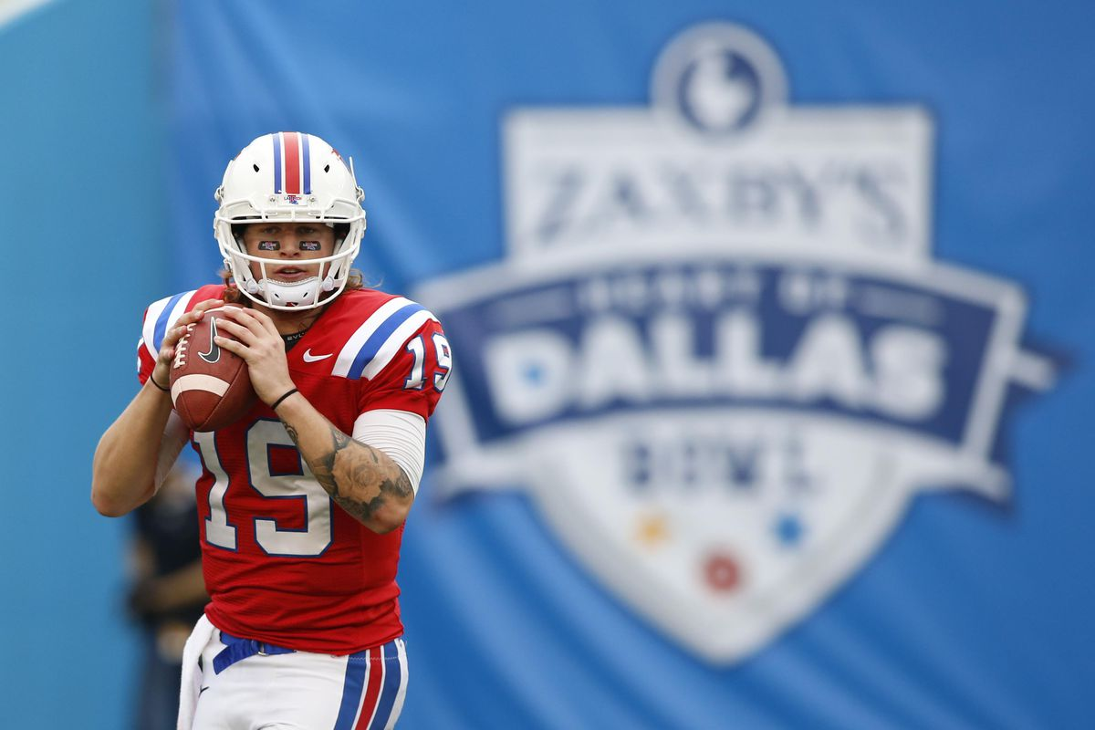 Cody Sokol warms up for the Heart of Dallas Bowl