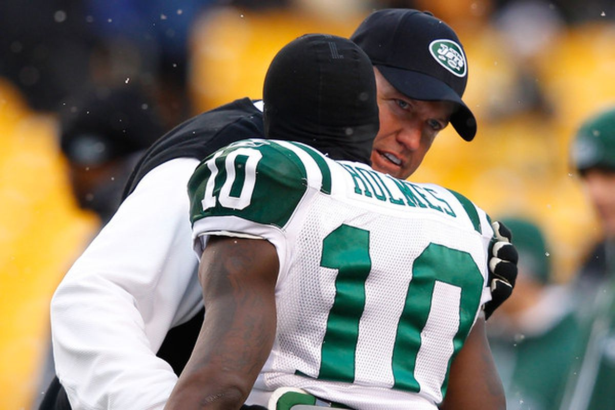 PITTSBURGH - DECEMBER 19:  Head coach Rex Ryan greets Santonio Holmes #10 of the New York Jets before the game against the Pittsburgh Steelers on December 19 2010 at Heinz Field in Pittsburgh Pennsylvania.  (Photo by Jared Wickerham/Getty Images)