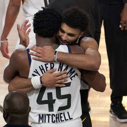 Utah Jazz's Donovan Mitchell (45) and Denver Nuggets' Jamal Murray, center rear, greet each other after their NBA first round playoff basketball game, Tuesday, Sept. 1, 2020, in Lake Buena Vista, Fla. The Nuggets won 80-78.