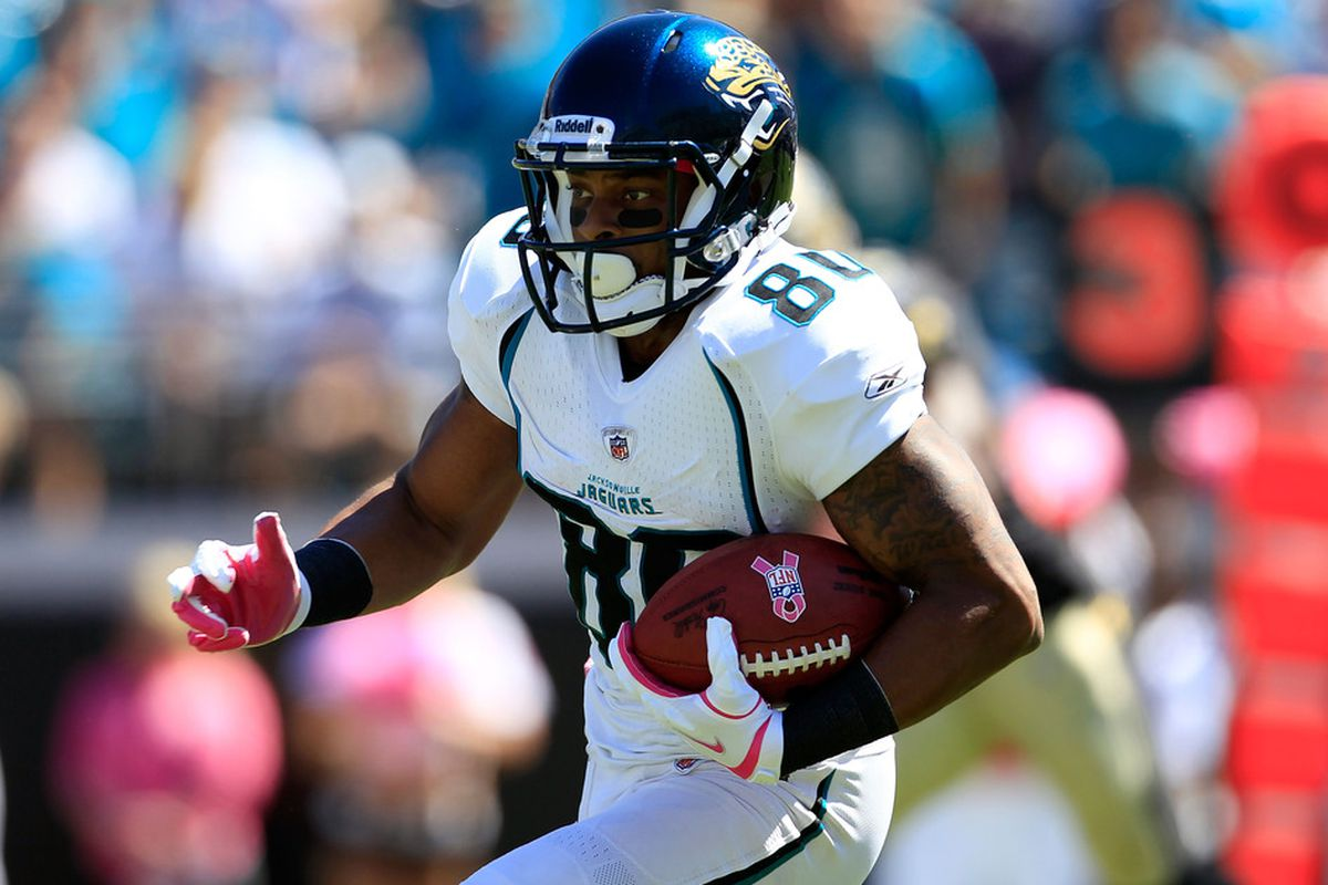 JACKSONVILLE, FL - OCTOBER 02:   Mike Thomas #80 of the Jacksonville Jaguars runs following a reception during a game against the New Orleans Saints at EverBank Field on October 2, 2011 in Jacksonville, Florida.  (Photo by Sam Greenwood/Getty Images)