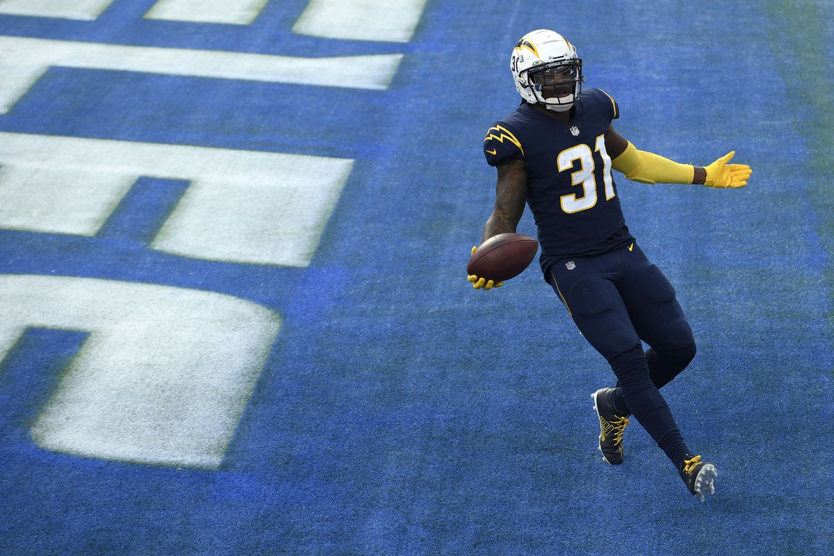 Kalen Ballage #31 of the Los Angeles Chargers celebrates a second quarter touchdown against the Las Vegas Raiders at SoFi Stadium on November 08, 2020 in Inglewood, California.