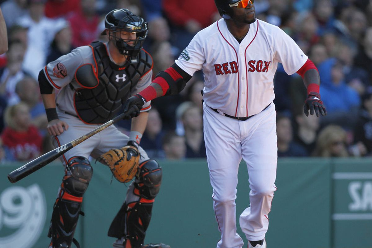 May 6, 2012; Boston, MA, USA; Boston Red Sox designated hitter David Ortiz (34) hits a double to center during the eighth inning against the Baltimore Orioles at Fenway Park.  Mandatory Credit: Greg M. Cooper-US PRESSWIRE