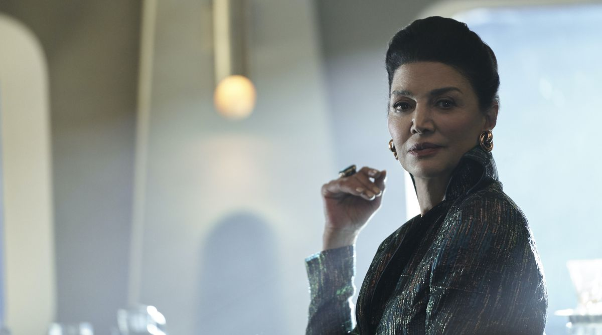 ShohrehAghdashloo, as Chrisjen Avasarala from The Expanse, faces the camera and smiles