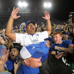 Brigham Young Cougars head coach Kalani Sitake celebrates as he is lifted into the air by fans as BYU defeats Utah in an NCAA football game at LaVell Edwards Stadium in Provo on Saturday, Sept. 11, 2021. BYU won 26-17, ending a nine-game losing streak to the Utes.