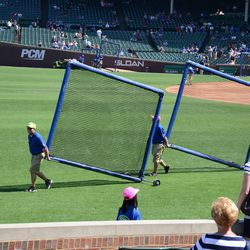 2:21 p.m. Batting practice screens being removed from the infield -