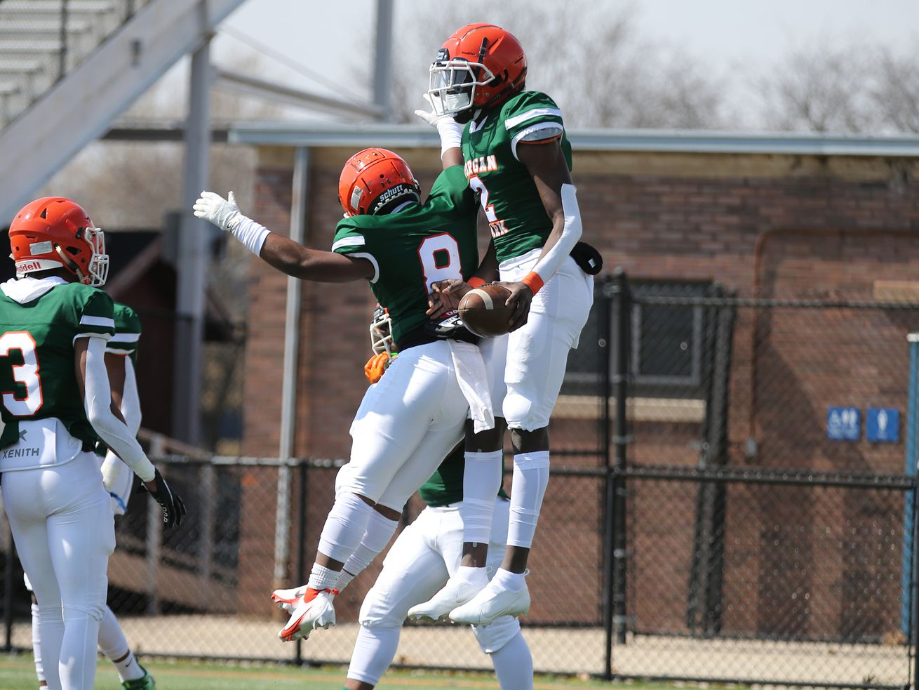 Morgan Park's Aaron Warren (2) celebrates with Jayquawne Hayes (8) after scoring a touchdown against Curie.
