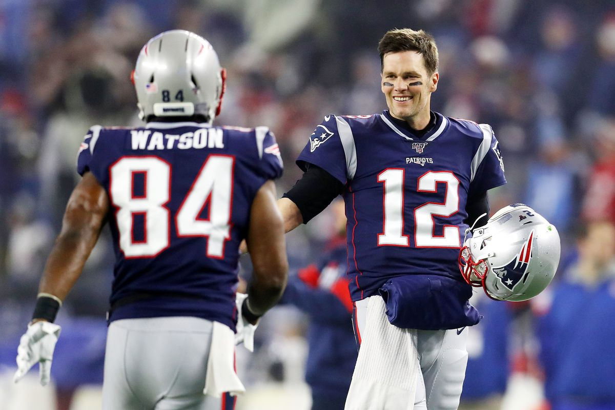 Benjamin Watson #84 of the New England Patriots and teammate Tom Brady #12 show camaraderie before taking on the Tennessee Titans in the AFC Wild Card Playoff game at Gillette Stadium on January 04, 2020 in Foxborough, Massachusetts.
