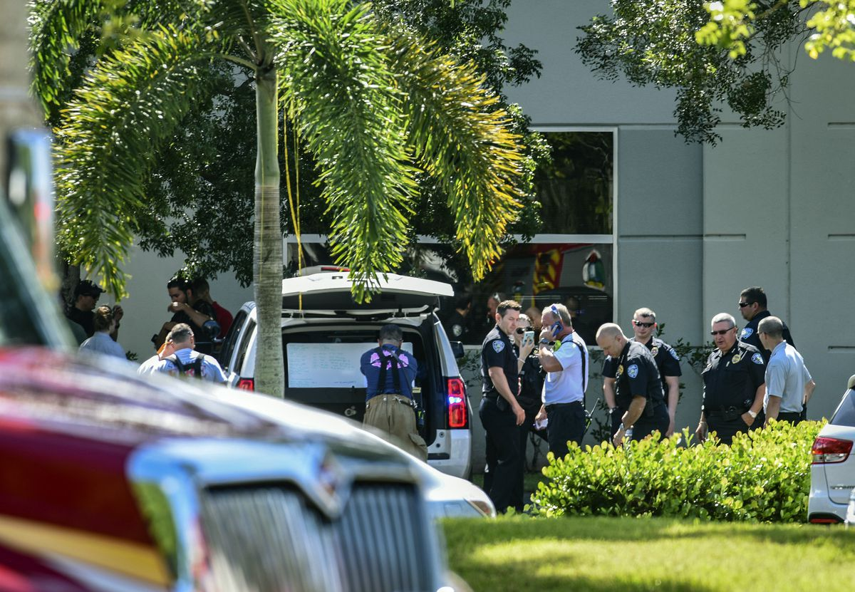 Law enforcement officials from the Broward Sheriff's Office bomb squad and Sunrise Police and Fire Rescue at the scene where a suspicious package was found Wednesday inside the Sunrise (Fla.) Utility Administrative Center in Sunrise; Rep. Debbie Wasserman