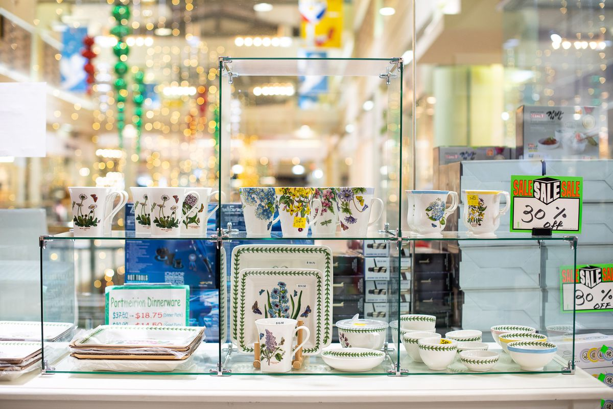 A display at ABC Plaza shows sets of dinnerware.