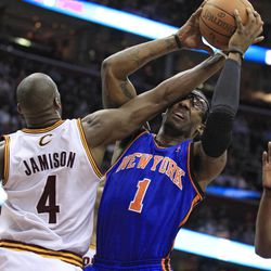 New York Knicks' Amare Stoudemire (1) is fouled by Cleveland Cavaliers' Antawn Jamison (4) during the first quarter in an NBA basketball game on Friday, April 20, 2012, in Cleveland.