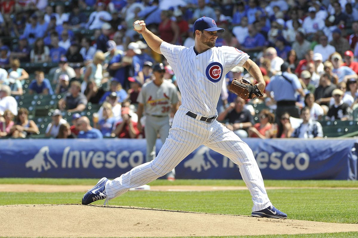 Starting pitcher Randy Wells of the Chicago Cubs delivers during the first inning against the St. Louis Cardinals at Wrigley Field in Chicago, Illinois.  (Photo by Brian Kersey/Getty Images)