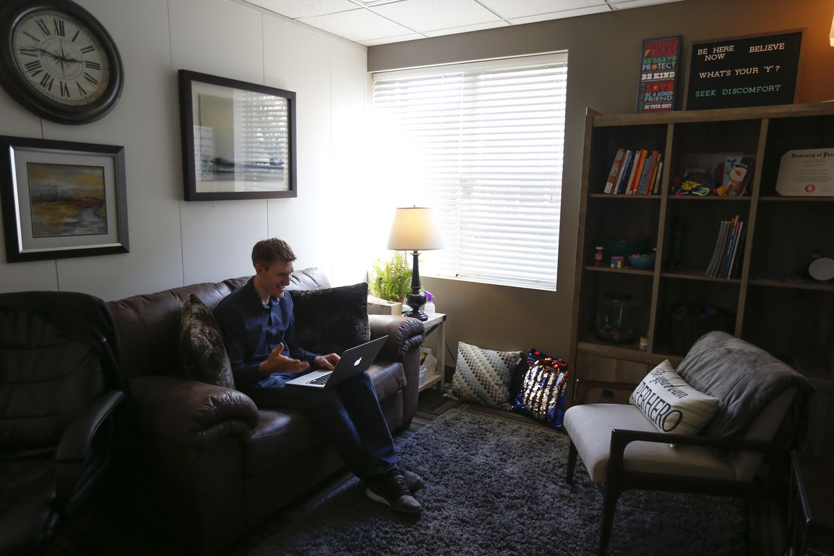 Shaun Reeve, an associate clinical mental health counselor, counsels a client via telehealth from his office at Grandview Family Counseling in Bountiful on Wednesday, April 1, 2020.