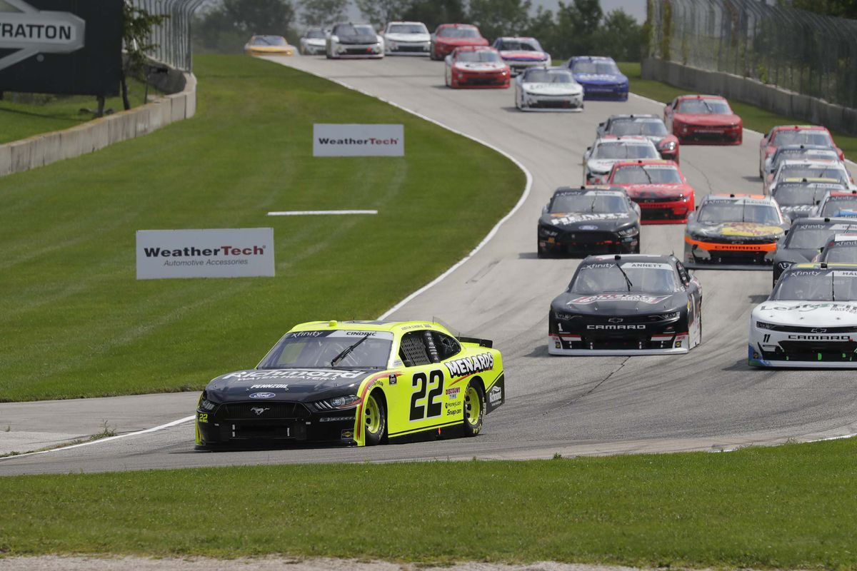 Austin Cindric (22) leads the pack during a yellow flag during the Henry 180, Saturday, August 8, 2020, at Elkhart Lake, Wis. Road America.