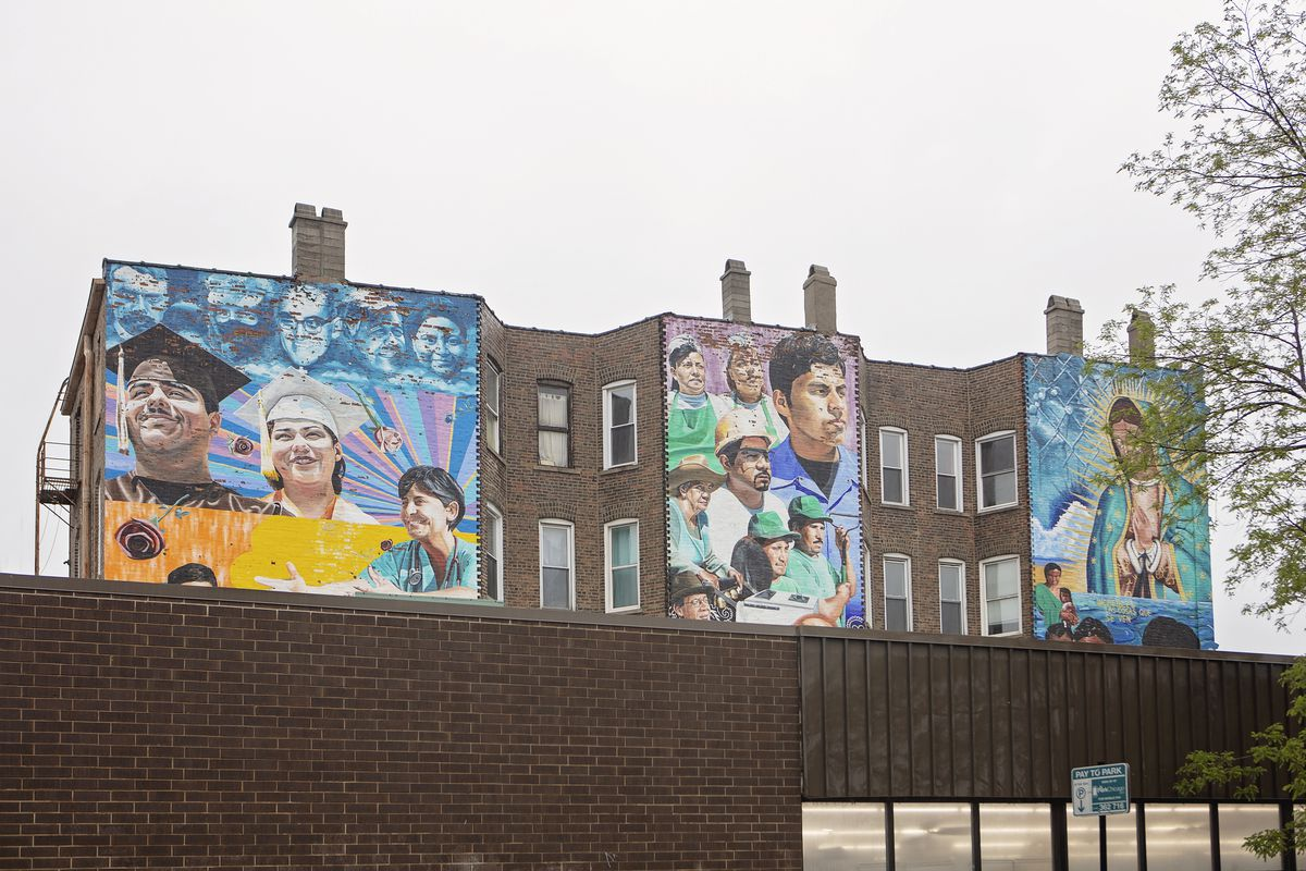 A building with a mural of people smiling.