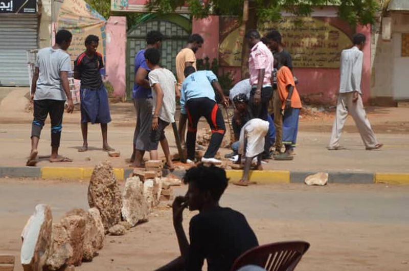 Bricks are laid by protesters to block a street in the Sudanese capital Khartoum to stop military vehicles from driving through the area on Wednesday, June 5, 2019. The death toll in Sudan amid a violent crackdown on pro-democracy protesters and the dispe