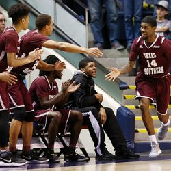 After draining a 3-point shot, Texas Southern Tigers forward Lamont Walker (14) celebrates with teammates on the bench as BYU and Texas Southern play an NCAA basketball game in Provo at the Marriott Center on Saturday, Dec. 23, 2017. BYU won 73-52.